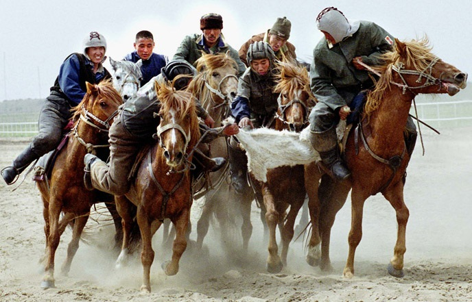 KAZAKH RIDERS FIGHT FOR GOAT'S BODY DURING NATIONAL SOPTR KOKPAR IN PAVLODAR.