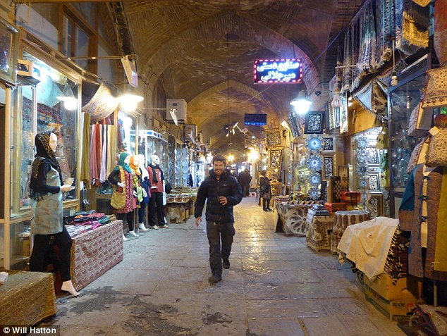 3550490B00000578-3641246-Walking_through_one_of_the_souks_in_Tehran_which_is_laden_with_h-a-10_1466072491650